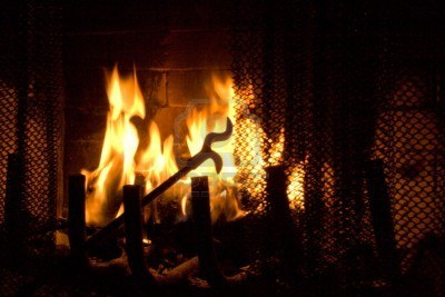 5583758-fireplace-poker-in-flames-of-fire-background