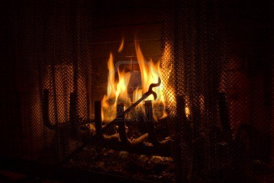 5583763-fireplace-poker-in-flames-of-fire-background