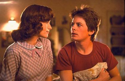 Michael J.Fox's mom wants to bone him. This is an example of bad time traveling etiquette. Back To The Future, Universal Pictures, 1985.