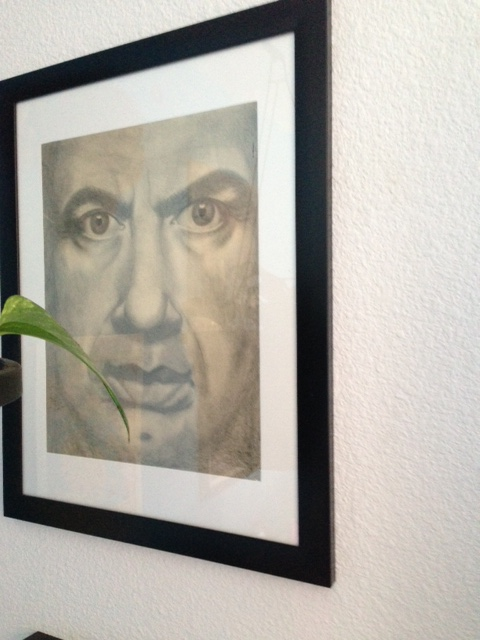 Forgive the odd angle. He's sort of hiding behind a plant. Not that I hid my own art behind a plant. Very interesting.
