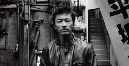 Tadanobu Asano in Electric Dragon 80000V. Image from cinemastrikesback.com