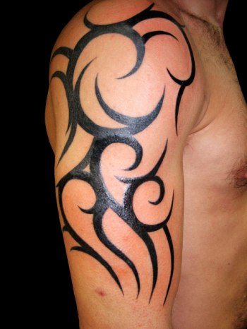 White guy sporting a tribal tattoo. Image from tattoosku.com